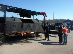 Shooting around the Martin's massive smoker, which can handle multiple whole hogs.